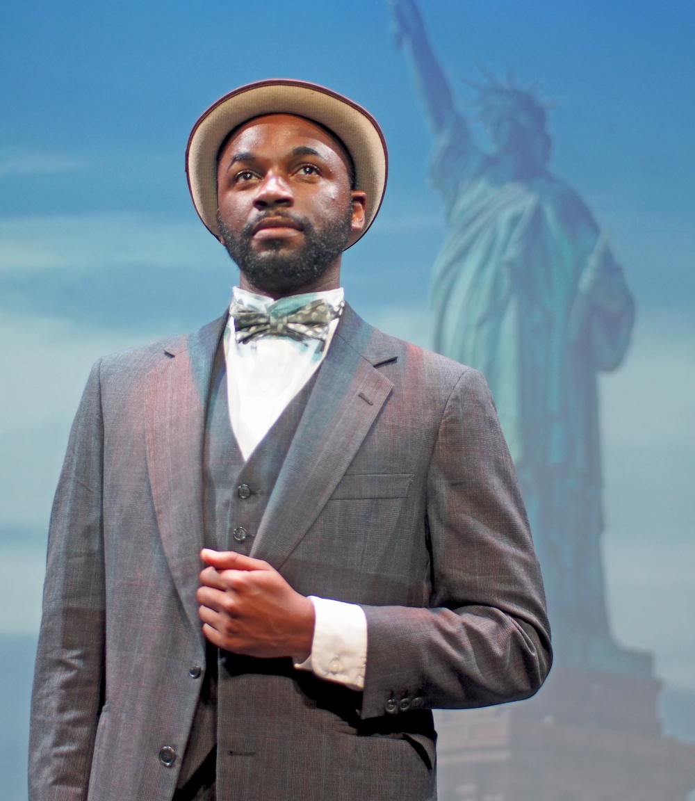 Ragtime's Booker T. Washington with the Statue of Liberty