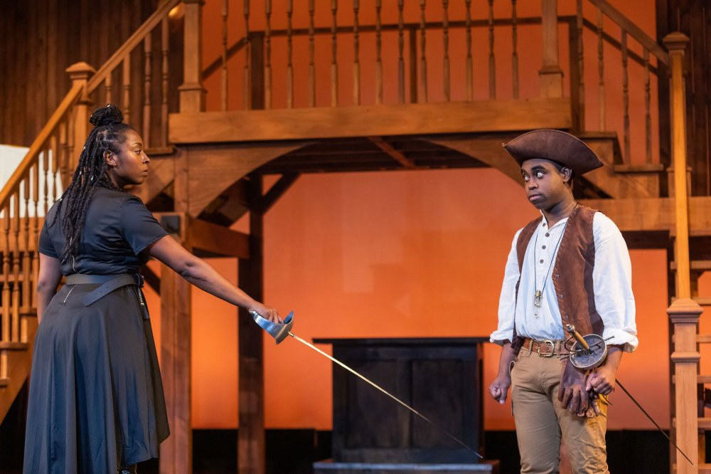 The Greater Boston Stage Company Tonasia Jones as Madame de Treville and Marc Pierre as D'Artagnan