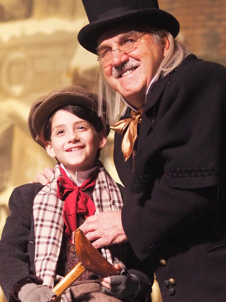 Company Theatre A Christmas Carol Owen George as Tiny Tim and Philip Hebert as Scrooge